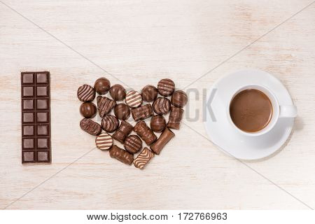 Valentine Background With Chocolate Truffles And Coffee Cup.