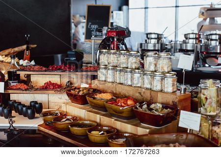 Breakfast buffet in the restaurant with an open kitchen. Luxury open kitchen in hotel restaurant facility showing serving buffet breakfast dinner lunch meal
