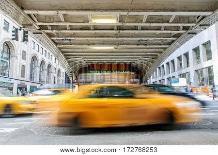 New York February 21 2017: Blurred view of taxis moving along the 42nd street at Pershing Square.