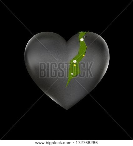 black background and the large stone wounded heart-stone with traces and flowering grass