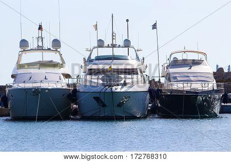 three yachts on the docks of port Mandraki Rhodes Greece