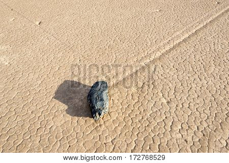 Moving stone in the desert of Death Valley National Park, California,