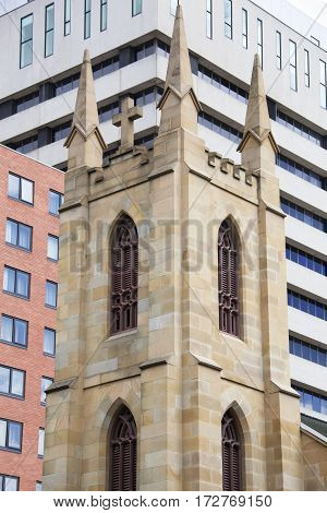 The view of church tower with modern buildings in a background in Hobart downtown (Tasmania).
