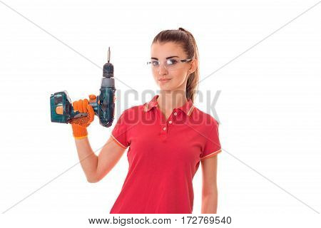 young attractive brunette woman builder in uniform with glasses and drill in her hands make reovations isolated on white