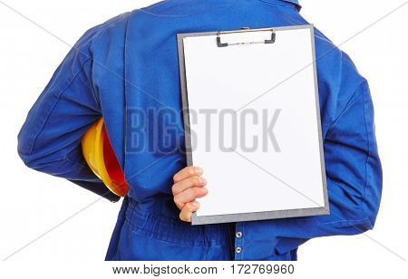 Construction worker holding empty clipboard behind his back