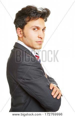 Serious looking business man with his arms crossed