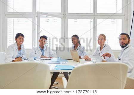 Meeting with interracial group of doctors as team in hospital