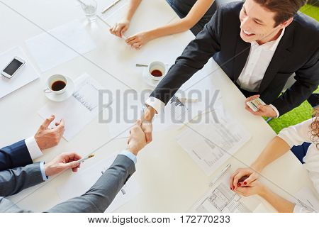 Business people handshake as sign of partnership