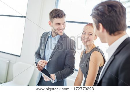 Consulting team with tablet computer at business meeting