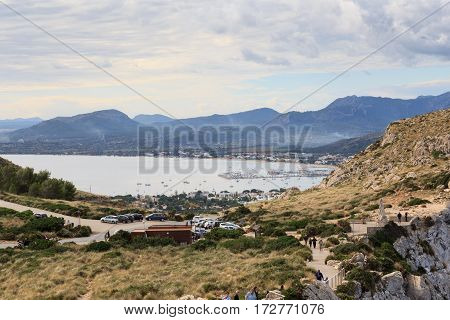 Port de Pollenca, Spain - November 7, 2016: Port de Pollenca mountain panorama and Mediterranean Sea, Majorca. Port de Pollenca is the most northerly town in Majorca.