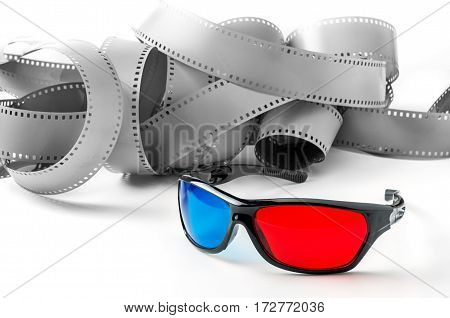 3d glasses and film strip on a white background