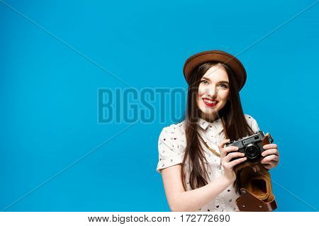 Stylish Girl With Camera. Blue Background. Summer Time