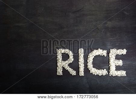 Rice In The Form Of Words. View From Above.