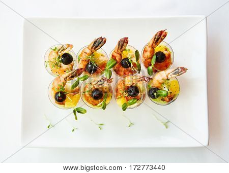 Shrimp, avocado, tomato, salmon cocktail salad served in a glass