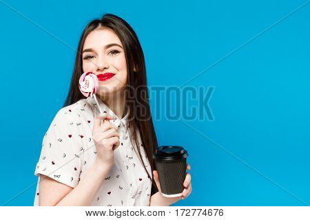 Portrait Of Beautiful Woman With Lolly Isolated On Blue Background. Portrait Of Beautiful Brunette G