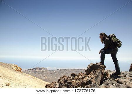 adventurous spanish mountain climber on the top of Teide