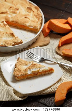 Homemade Pumpkin Pie for Thanksigiving on old wood table