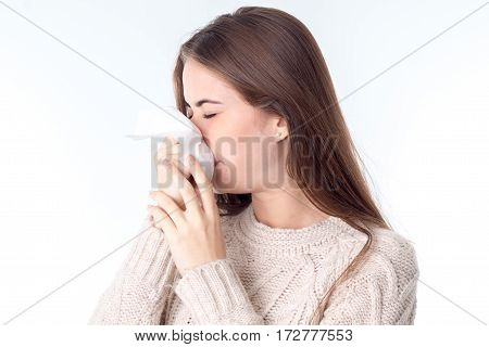 girl wipes her nose kerchief closing your eyes is isolated on a white