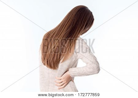 girl with long hair is kept on the side is isolated on a white