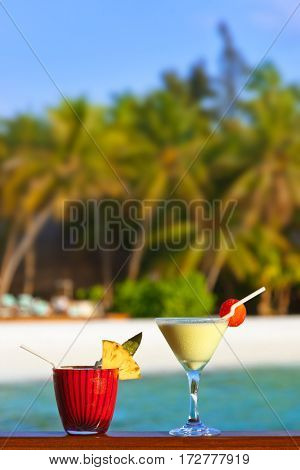 Fruit cocktail on Maldives beach - travel background
