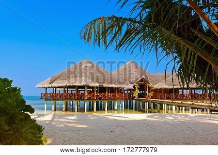 Cafe on tropical Maldives island - nature travel background