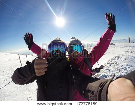Young skiers couple happy together in mountain
