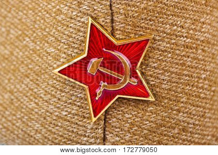Soviet State Star on forage-cap - russian background