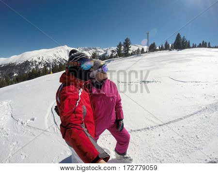 Young skiers enjoying together in mountain