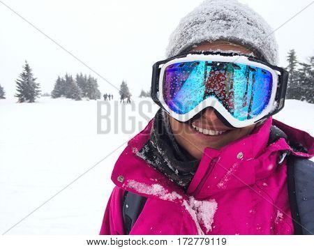 Smile female skier on skiing terrain- close up