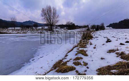 Early evening in frozen pond. Moravian landscape Boskovice.