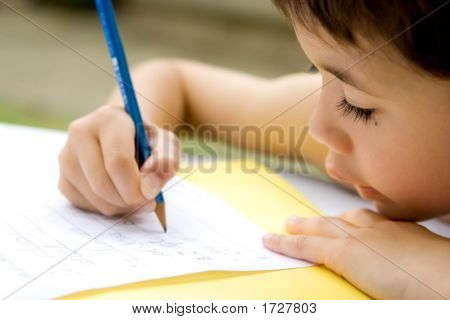 Young Boy Practicing Writing, Outdoors