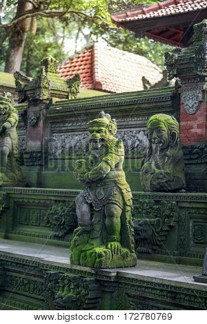 hindu statues on standing on the steps of the temple in the Monkey Forest Sanctuary in Ubud, Bal