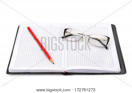 Notebook and glasses isolated on white background.