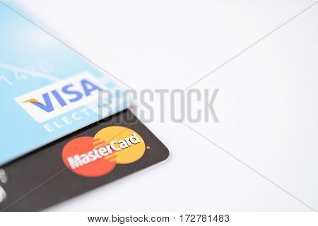 MINSK, BELARUS - February 22, 2017. Visa and Mastercard logos on credit cards on white. studio shot.