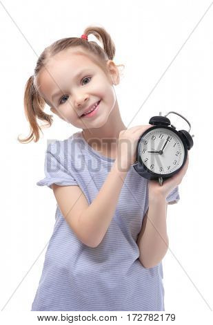 Cute little girl with alarm clock on white background