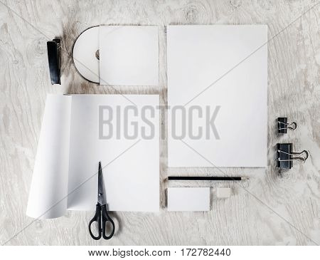Mock up for branding identity. Photo of blank stationery and corporate identity template on light wooden table background. Responsive design mockup. Blank objects for placing your design. Top view.