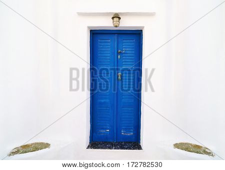Cyclades architecture - traditional blue wooden door at Sifnos island Greece