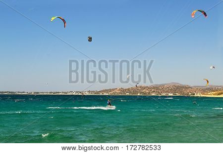 NAXOS GREECE, AUGUST 27 2014: people doing kitesurf at Naxos island Cyclades Greece. Editorial use.