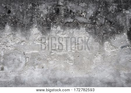 old house wall with cracked plaster shades of gray. grunge textured background