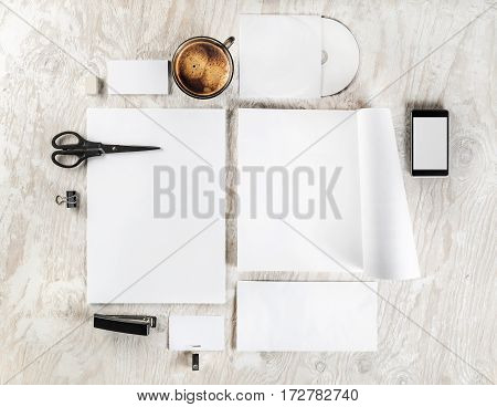 Photo of blank stationery and corporate identity template on light wooden table background. Mock up for branding identity. Responsive design mockup. Blank ID objects for placing your design. Top view.