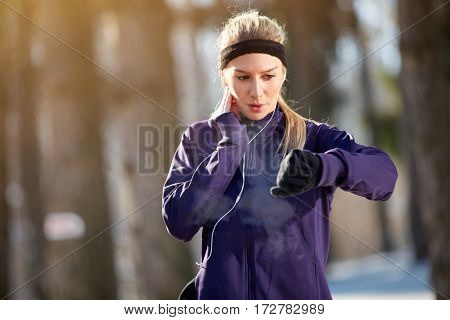 Female athlete measure pulse on cardio training outdoor
