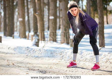 winter sporty woman on break after running