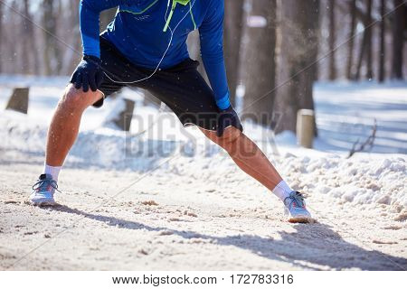 Concept of jogger legs while stretching outdoor