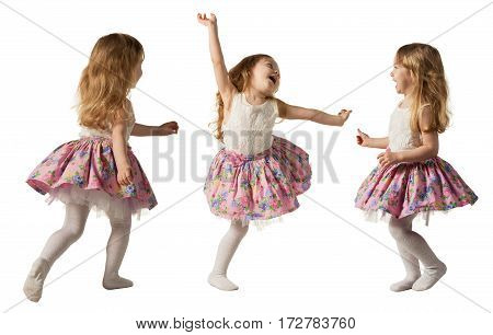 Little cute girl jumping, running, dancing, having fun. Isolated on white background