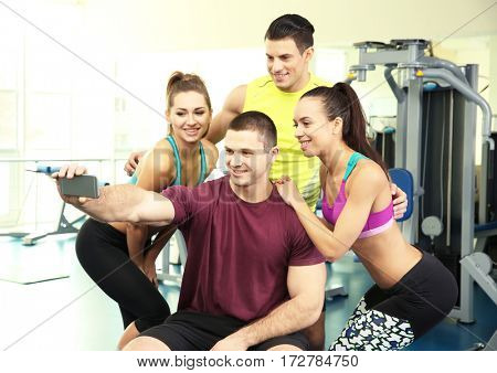 Group of people taking selfie in gym