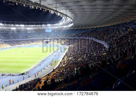 Panoramic view of modern stadium during football match