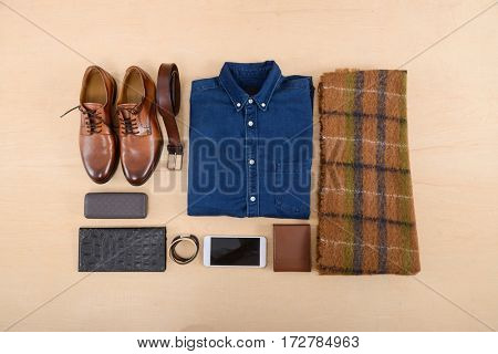 Set of clothes and various accessories for men on old wooden background
