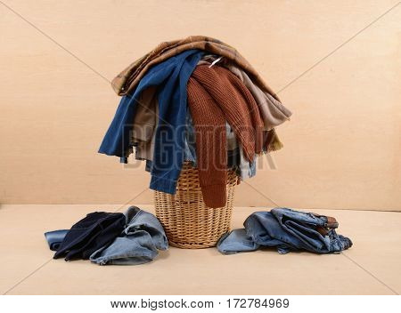 full of jeans, clothes in Basket