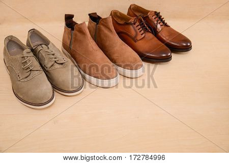 Men's boots ,shoes and wooden background