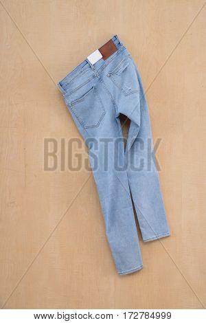 Back blue denim jean on wood background